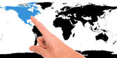 Hand pointing on map — Stock Photo