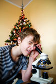 Young boy with christmas present — Stock Photo