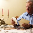 Royalty-Free Stock Photo: Senior man looking at old photographs.