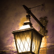 Street lamp shining - Stock Photo