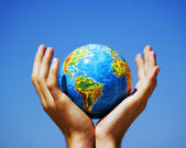Earth globe in hands. Conceptual image — Stock Photo