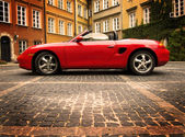 Sport car in the old town scenery — Stock Photo