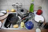 Pile of dirty dishes in the metal sink — Foto Stock