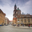 Prague. Malostranske square, St. Nicholas Church - Stock Photo
