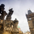 Statues on Charles Bridge and Bridge Tower. Prague — Stock Photo