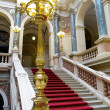 Red carpet on stairs. National Museum in Prague — Stock Photo