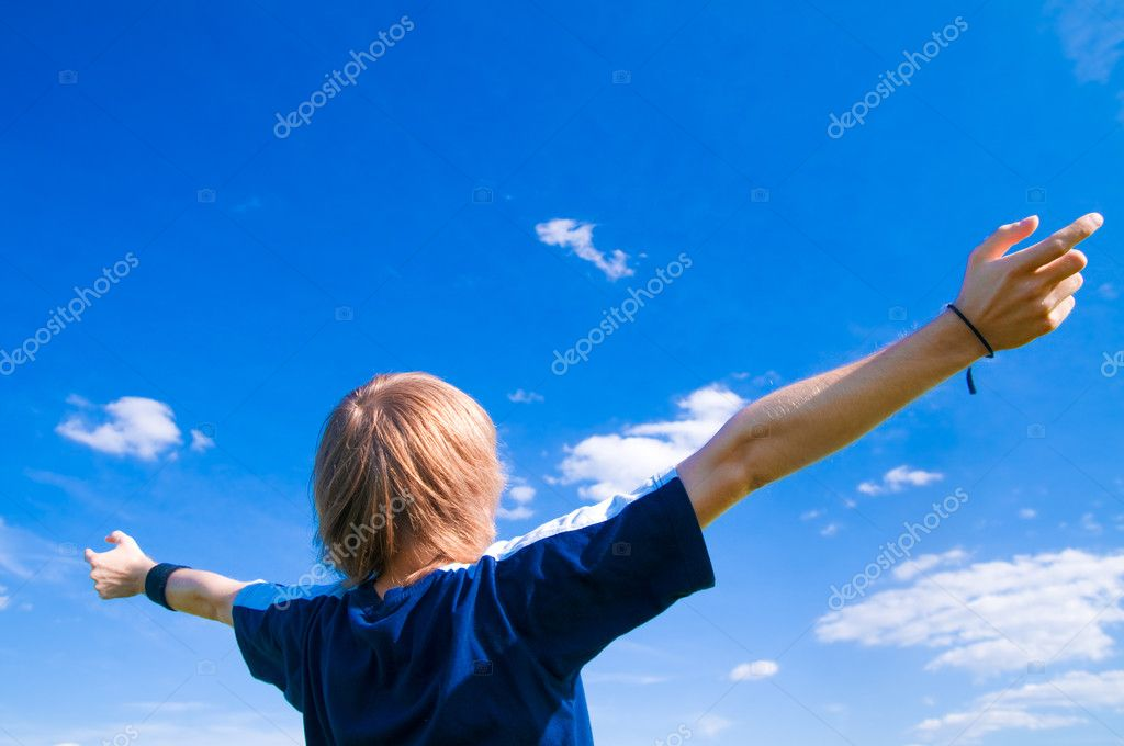 Happy man with arms up on blue sky — Stock Photo #3785822