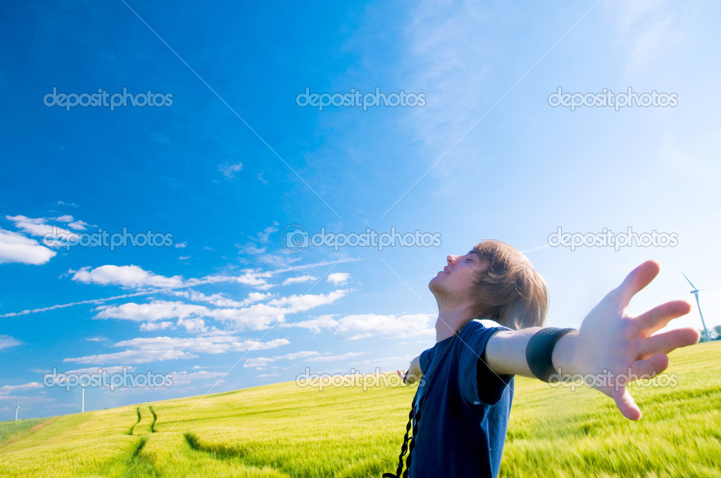 Happy man with arms up on summer lanscape — Stock Photo #3785829