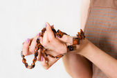 Female hands show beautiful necklace — Stock Photo