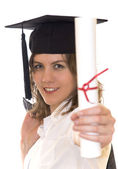 Young woman holding graduate diploma — Stock Photo