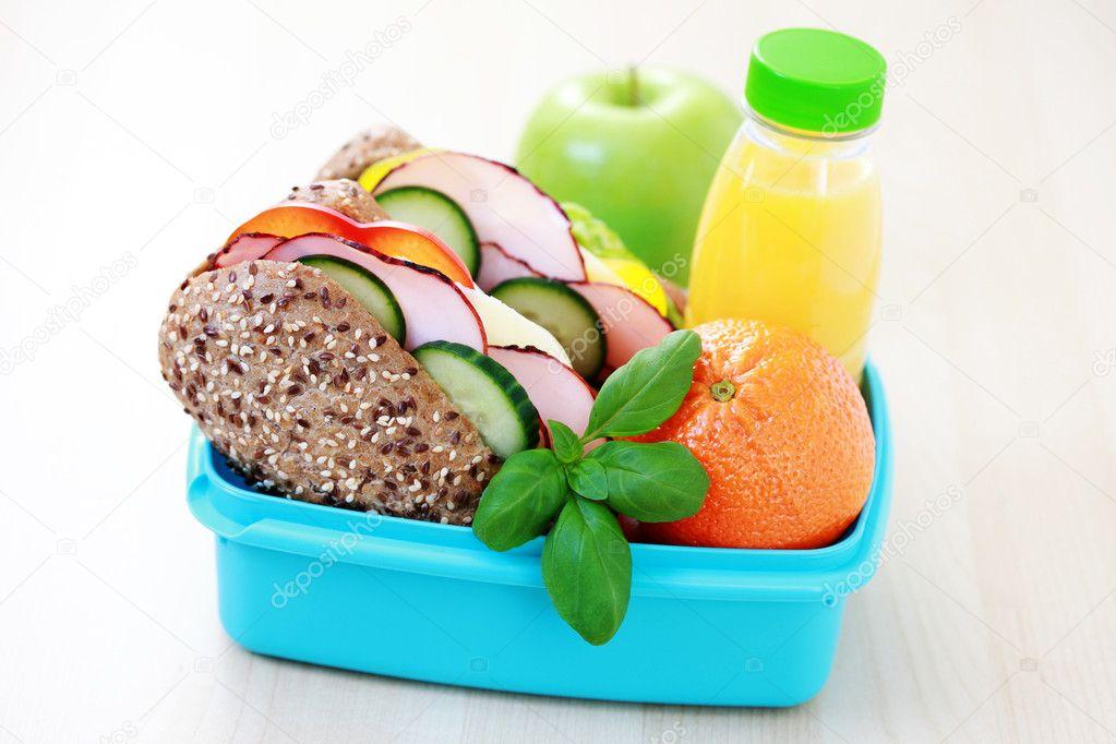 Lunch box with delicious sandwich and fruits - food and drink — Stock Photo #2981532