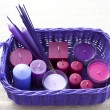 Basket with candles — Stock Photo