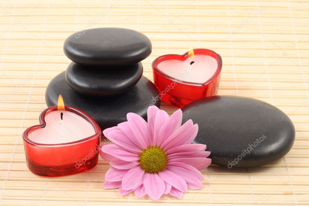 Stack of pebbles with candles and flower - aromatherapy  Stock Photo #4446721