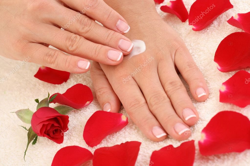 Beautiful hands with french manicure — Stock Photo #4449795