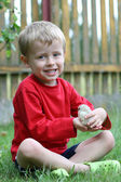 Boy and chicken — Stock Photo