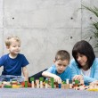 Family fun with wooden blocks — Stock Photo #4499738