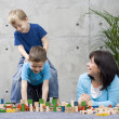 Family fun with wooden blocks — Stock Photo