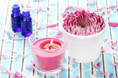 Essential oil flower and candle — Stock Photo