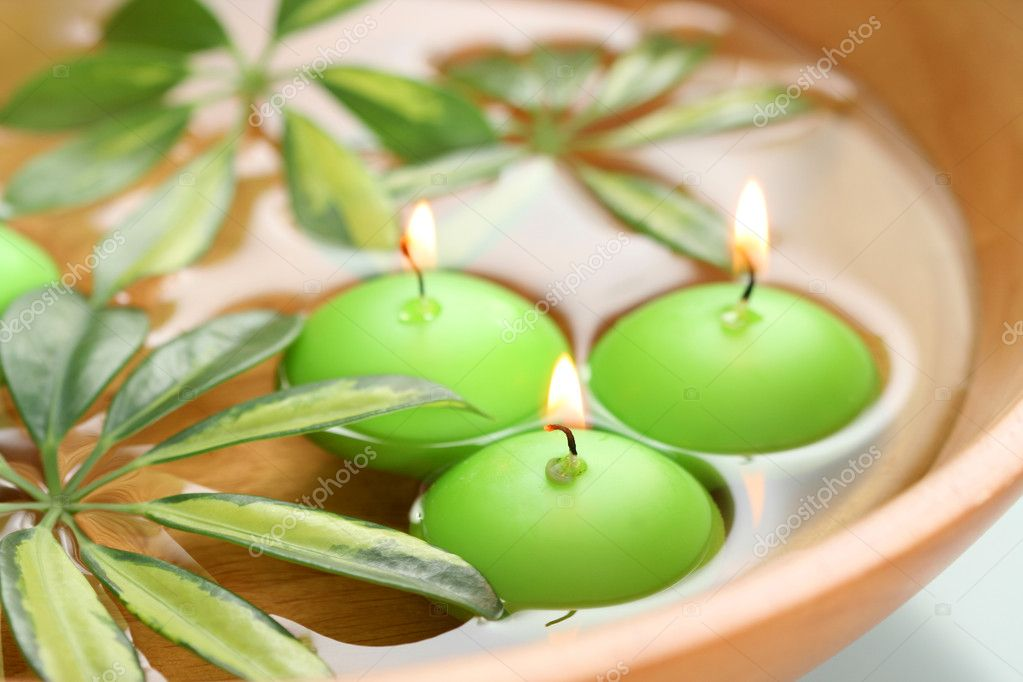 Bowl of water with candles - beauty treatment — Stock Photo #4497596
