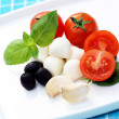 Mozzarella and cherry tomatoes - Stock Photo
