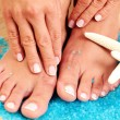 Sexy female feet and hands — Stock Photo