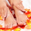 Feet care in bed - Stock Photo