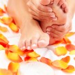 Feet care in bed — Stock Photo