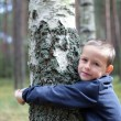 Boy and birch tree — Stock Photo #4574208