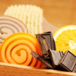 Chocolate and orange soaps - Stock Photo