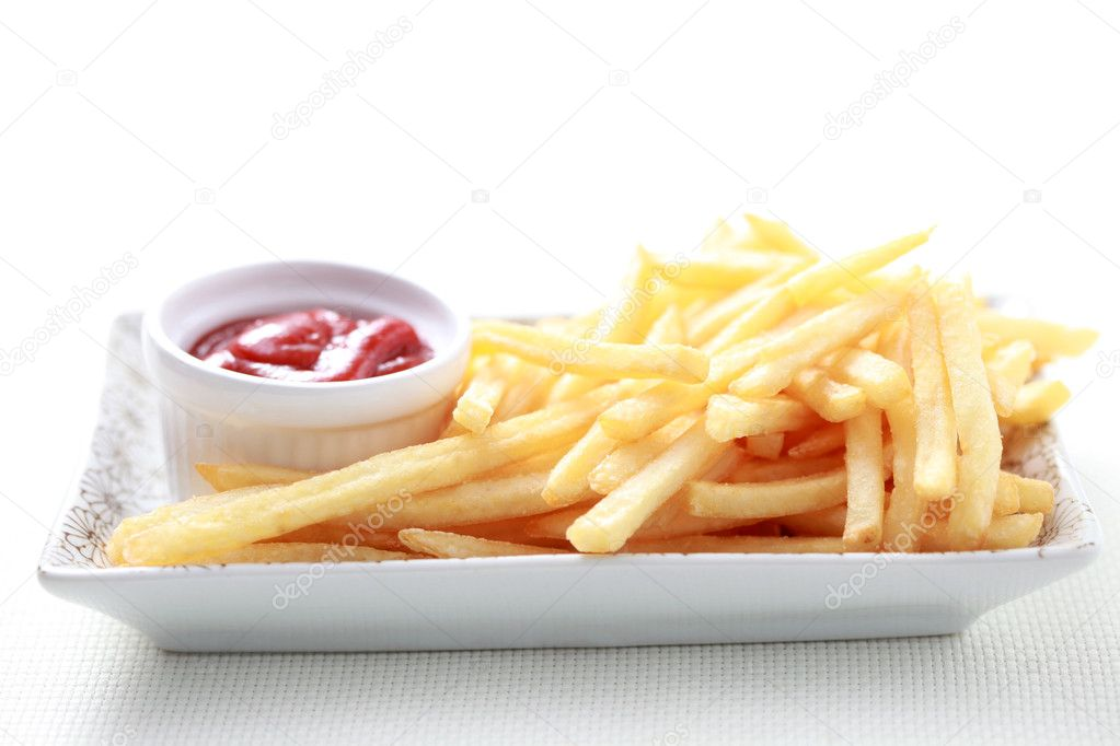 Close-ups of french fries and ketchup - food and drink  Stock Photo #4577482