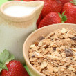 Healthy breakfast - musli and strawberries - Stock Photo