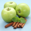 Apples and cinnamon - Stock Photo