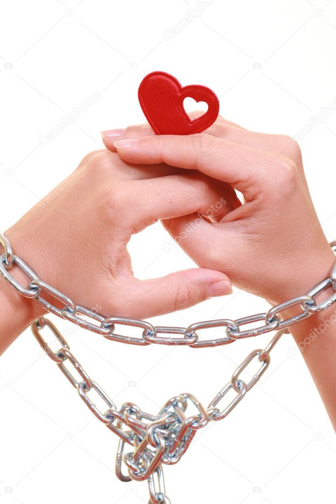 Hands with metal chain isolated on white - heartshaped  Zdjcie stockowe #4591420