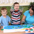 Preschoolers and fingerpainting — Stock Photo
