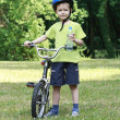 Preschooler and bike — Stock Photo #4605641
