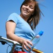 Woman and bike — Stockfoto #4610070