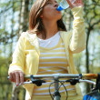 Woman and bike - Stock Photo