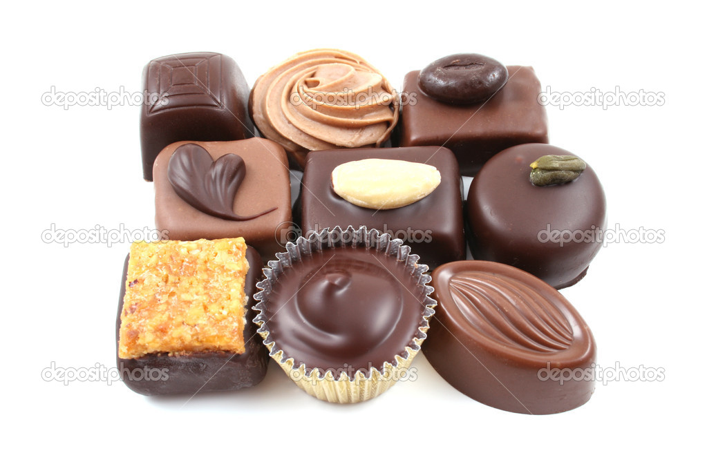 Close-ups of mixed chocolates isolated on white  Stock Photo #4610359