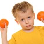 Boy and oranges — Stock Photo