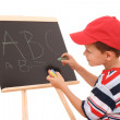 Blackboard and child - Stock Photo