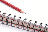 Spiral book and pencil — Stock Photo