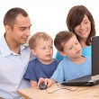 Family using laptop — Stock Photo