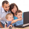 Family using laptop — Stockfoto