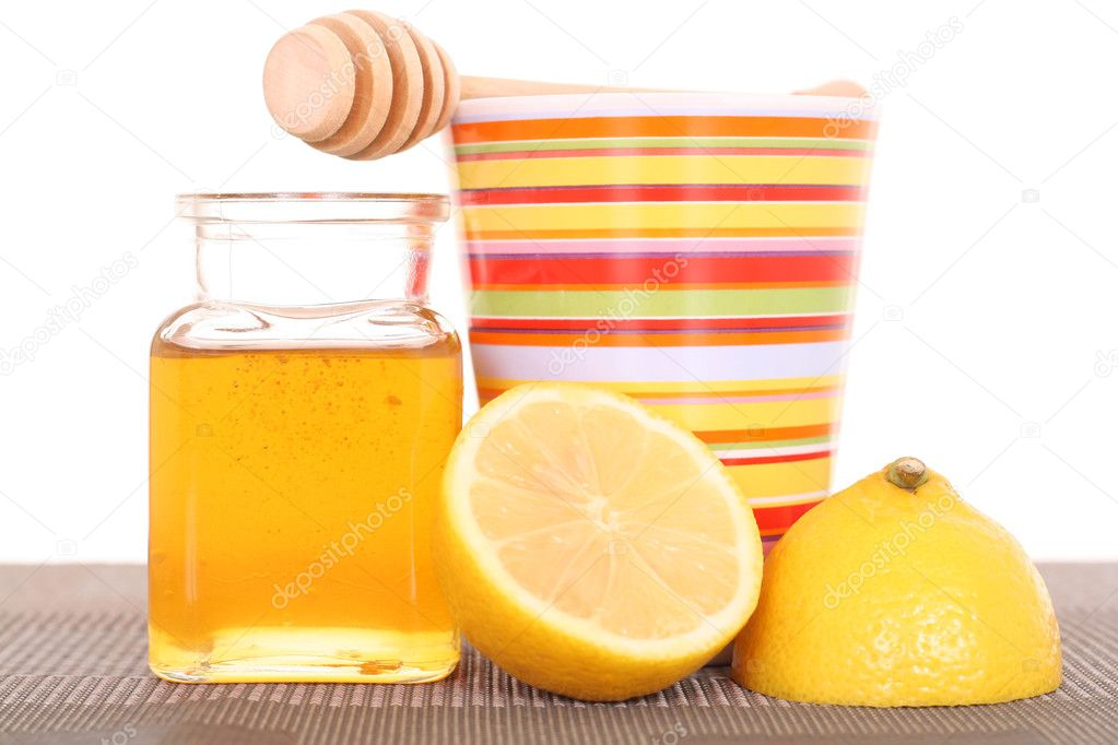 Cold and flu remedy - honey and lemon — Stock Photo #4648001