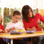 Preschoolers and wooden blocks — Stock Photo