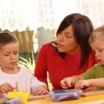 Preschoolers with wooden blocks — Stock Photo