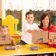 Preschoolers and wooden blocks — Stock Photo