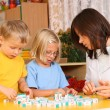 Letters and preschoolers — Stock Photo