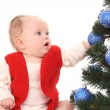 Baby girl and Christmas tree — Stock fotografie