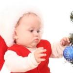 Baby girl and Christmas tree — Stock Photo
